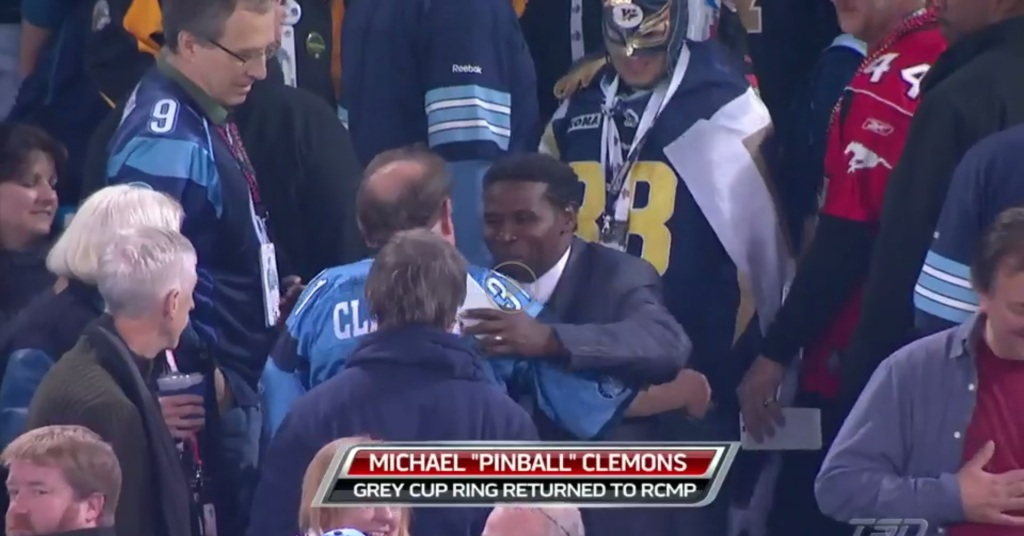Here I am providing security for Pinball Clemons at the 100th Grey Cup in stock footage.