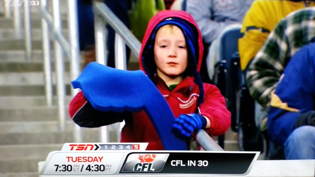 Actual TSN broadcast image of a ~9 year old Blue Bomber fan who has given up.